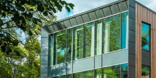 Cropped photo of a building with static solar control glass with sunny background