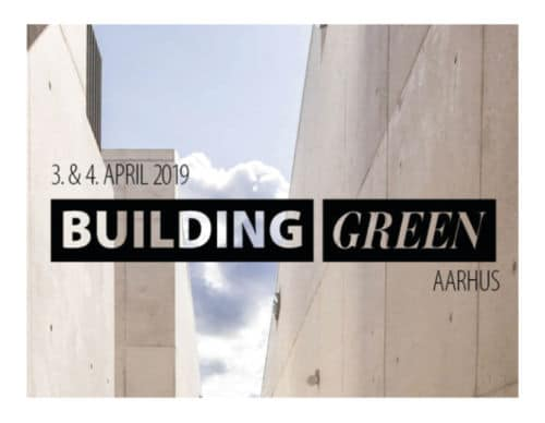 """The text """"Building Green Aarhus"""" in a black block over a background of grey buildings"""