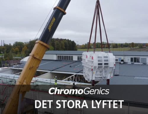 """Cover Photo for news update about """"The Big Lift"""". A crane is delivering a machine to ChromoGenics factory."""