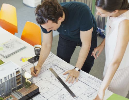 Architect drafting blueprints in office