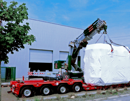 Sputter machines are being delivered to ChromoGenics on a red trailer.